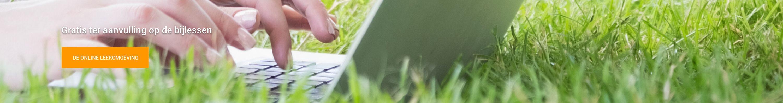 laptop op grasveld